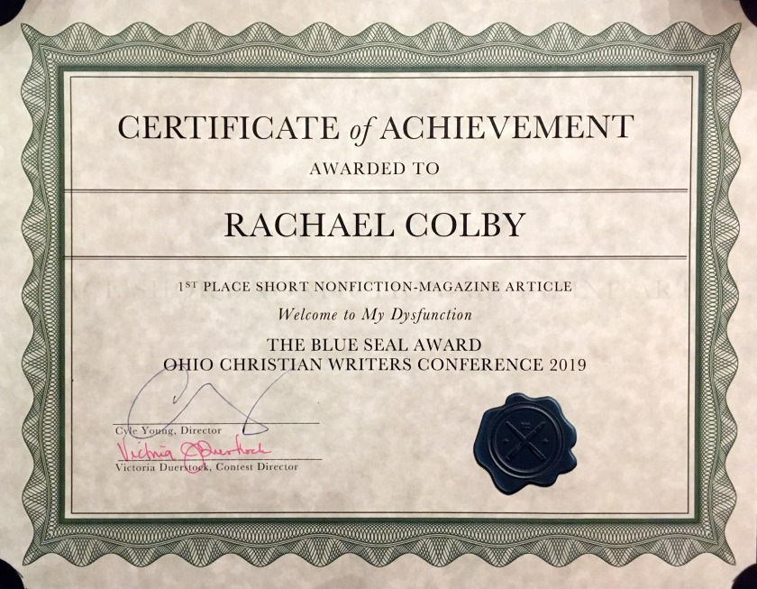 Rachael-M-Colby-Welcome-to-My-Dysfunction-First-Place-Ohio-Christian-Writers-Conference-2019-The-Blue-Seal-Award